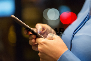 close up of businesswoman hands with smartphone