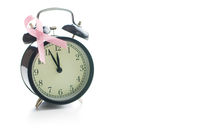 Pink breast cancer ribbon. Breast cancer symbol and alarm clock.