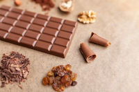 Delicious sweet chocolate bar and ingredients