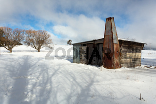 Rustic log shed or stable in rural countryside with full coverag