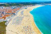 People ocean beach Nazare Portugal