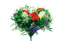 Heart shaped bunch of colorful spring flowers