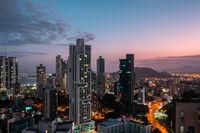 modern city skyline with sunset sky - skyscraper cityscape of Panama City