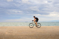 Man riding a bicycle waterfront