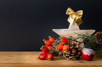 wooden Star with twig pine cone and rose hip background