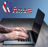 Senior caucasian man types about Q Anon deep state conspiracy