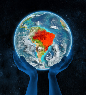 Brazil on planet Earth in hands
