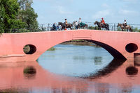 San Antonio de Areco, province Buenos Aires, Argentina - November 11, 2012: Gauchos (South American cowboy, is a resident of the South American pampas)  go to the fiesta through the famous bridge in the old town center during the Traditional Gauchos Feast