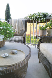 Wicker furniture on balcony