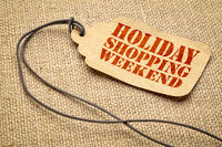 Holiday Shopping Weekend - text on a price tag