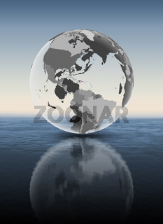 Dominican Republic on translucent globe above water