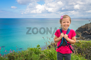 Cute happy little girl on the Cornish coast