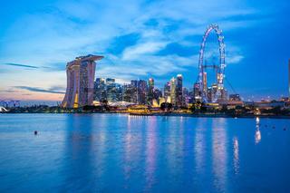 Singapore city skyline at twilight with view of Marina Bay