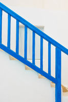 Blue staircase with railing