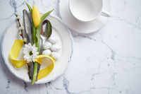 Spring Easter Table setting at white marble table. Top view