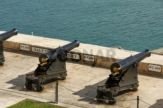 Saluting battery and cannons in row at Upper Barrakka gardens in Valletta in Malta