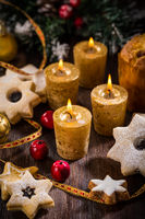 Christmas candles with homemade cookies in star shape