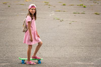Urban girl ride with penny skateboard