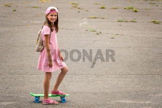 Urban girl ride with penny skateboard