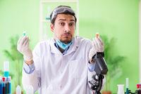 Man chemist working in the lab