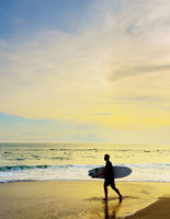 Surfer with surfboard beach. Bali