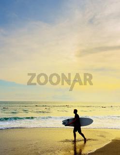 Surfer with surfboard beach. Bali