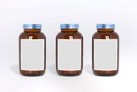 Blank glass medical bottles with tablets pills and label