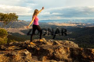 Bushwalker on rocky outcrop