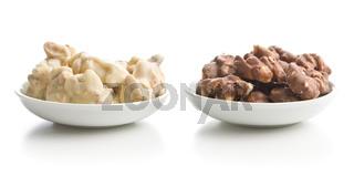 Peanuts covered white and dark chocolate.