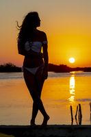 Hispanic Brunette Model Enjoying An Early Morning Sunrise