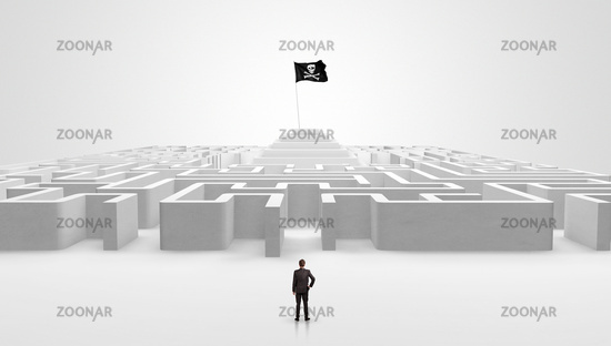 Man standing outside of a maze with pirate flag