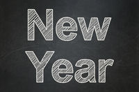 Holiday concept: New Year on chalkboard background