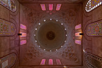 Decorated dome mediating ornate ceiling with floral pattern decorations at Khayer Bek Mausoleum, Cairo, Egypt