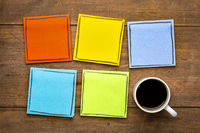 colorful, blank reminder notes with a cup of coffee