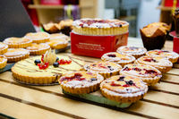 Various Different Types Of Sweet Cakes In Pastry Shop