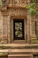 Fallen rocks seen through ruined temple doorway