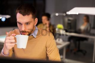 happy male office worker drinking coffee