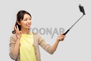 asian woman taking selfie by smartphone