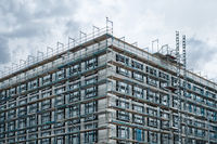 scaffolding on  house facade, apartment building under construction -
