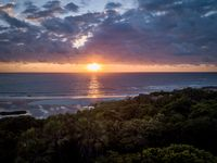 Sunrise above the Indian ocean and the forest.