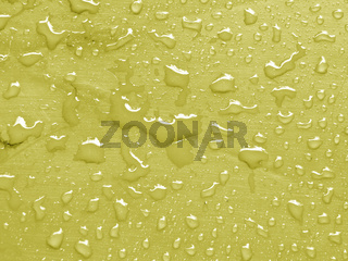 water drops on limelight colored metallic surface