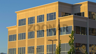 Panorama frame Commercial modern building exterior viewed against blue sky on a sunny day