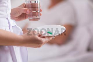 Nurse giving medication.