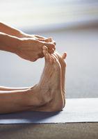 Man doing yoga stretching exercise