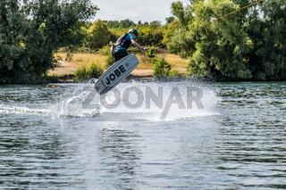 Boy having fun with waterski on the lake