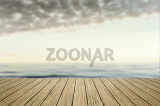 wooden jetty with blurred ocean background