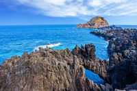 Rocks and grottoes of beautiful coast