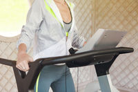 Young sporty woman on treadmill