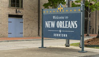 Sidewalk Sign Says Welcome to Downtown New Orleans