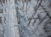 Electrical substation in the snow in winter. High voltage wires.